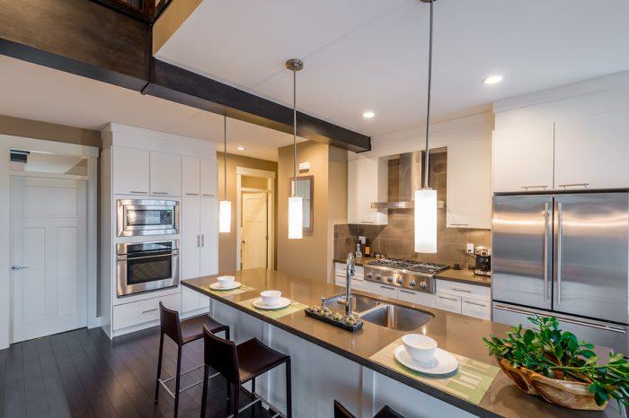 Modern, bright, clean, kitchen interior with stainless steel app
